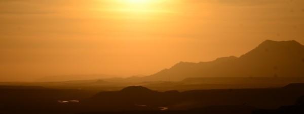 orange sunset over barren hills of Afghanistan