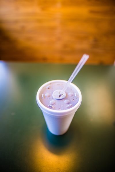 styrofoam cup with plastic straw